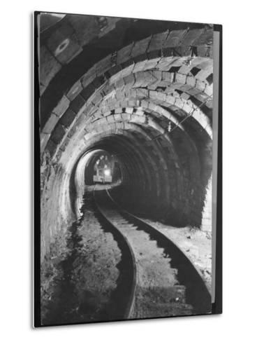 Electric Locomotive on Track in Powderly Anthracite Coal Mine Gangway, Owned by Hudson Coal Co-Margaret Bourke-White-Metal Print