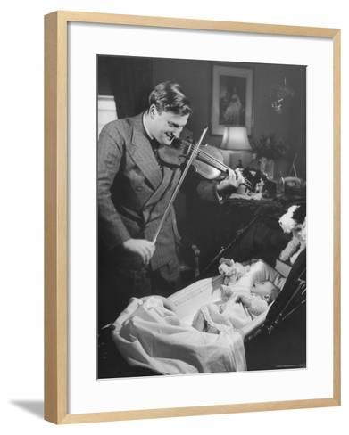 Violinist Yehudi Menuhin, Playing the Violin for His New Baby Daughter in Hotel Room-Hansel Mieth-Framed Art Print