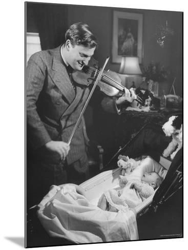 Violinist Yehudi Menuhin, Playing the Violin for His New Baby Daughter in Hotel Room-Hansel Mieth-Mounted Premium Photographic Print