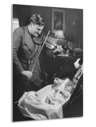 Violinist Yehudi Menuhin, Playing the Violin for His New Baby Daughter in Hotel Room-Hansel Mieth-Metal Print