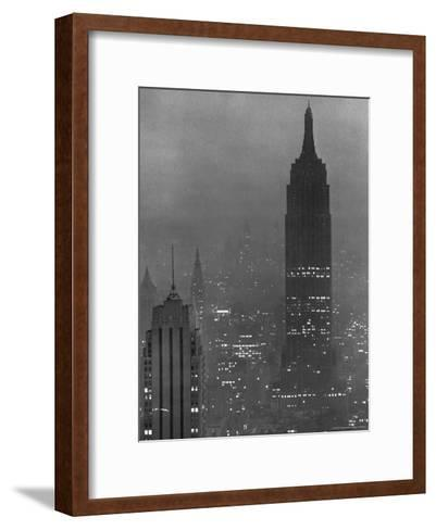 Silhouette of the Empire State Building and Other Buildings without Light During Wartime-Andreas Feininger-Framed Art Print