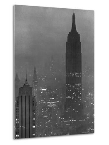 Silhouette of the Empire State Building and Other Buildings without Light During Wartime-Andreas Feininger-Metal Print