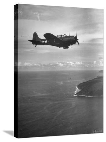 F-6 Hellcat Fighter Plane over Tanahmera Bay as Japanese Airfields at Hollandia, New Guinea-J^ R^ Eyerman-Stretched Canvas Print