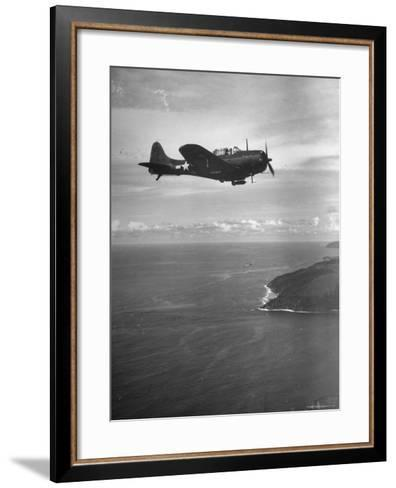 F-6 Hellcat Fighter Plane over Tanahmera Bay as Japanese Airfields at Hollandia, New Guinea-J^ R^ Eyerman-Framed Art Print