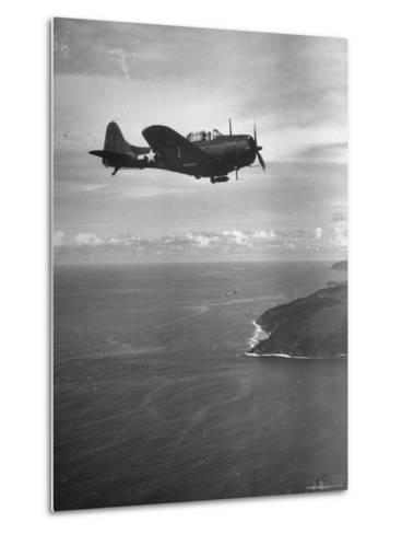 F-6 Hellcat Fighter Plane over Tanahmera Bay as Japanese Airfields at Hollandia, New Guinea-J^ R^ Eyerman-Metal Print