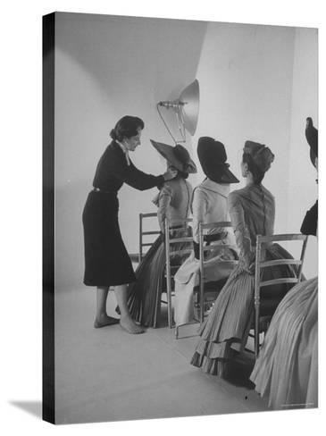 Vogue Magazine Editor Bettina Ballard Directing and prepping models for Photo Shoot at Studio-Nat Farbman-Stretched Canvas Print