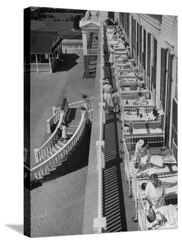 Nurses Tending to Afflicted Children as They Lie on a Sundeck in Sanitarium in Resort-Alfred Eisenstaedt-Stretched Canvas Print