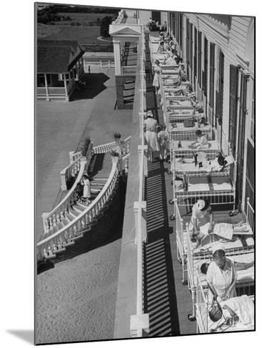 Nurses Tending to Afflicted Children as They Lie on a Sundeck in Sanitarium in Resort-Alfred Eisenstaedt-Mounted Photographic Print