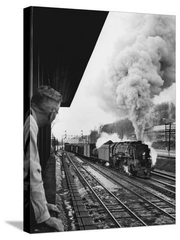 Signalman Nick Carter Watching Oncoming train at Station on the New York Central's Mohawk Division-Alfred Eisenstaedt-Stretched Canvas Print