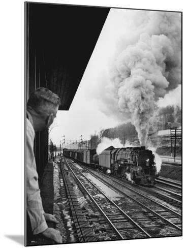 Signalman Nick Carter Watching Oncoming train at Station on the New York Central's Mohawk Division-Alfred Eisenstaedt-Mounted Photographic Print