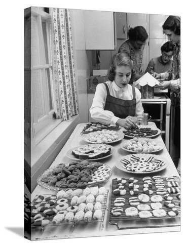 Cornell's Home Economics Student Lois Schumacher prepares food, Classmates Help with Decorations-Nina Leen-Stretched Canvas Print