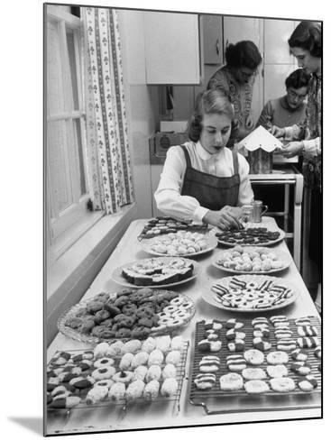Cornell's Home Economics Student Lois Schumacher prepares food, Classmates Help with Decorations-Nina Leen-Mounted Photographic Print