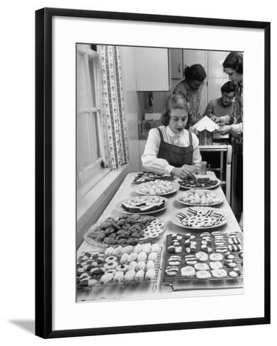 Cornell's Home Economics Student Lois Schumacher prepares food, Classmates Help with Decorations-Nina Leen-Framed Art Print