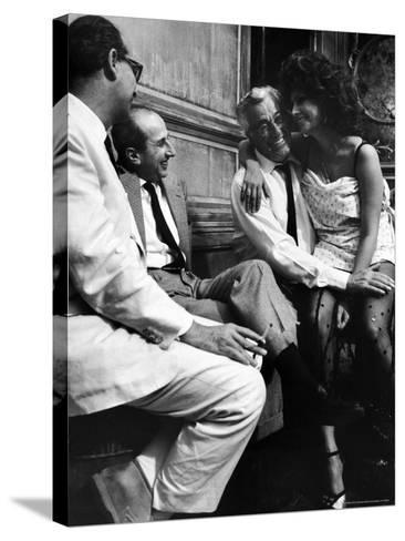"""Sophia Loren Sitting on Director Vittorio de Sica's Lap During Filming """"Marriage, Italian Style""""-Alfred Eisenstaedt-Stretched Canvas Print"""