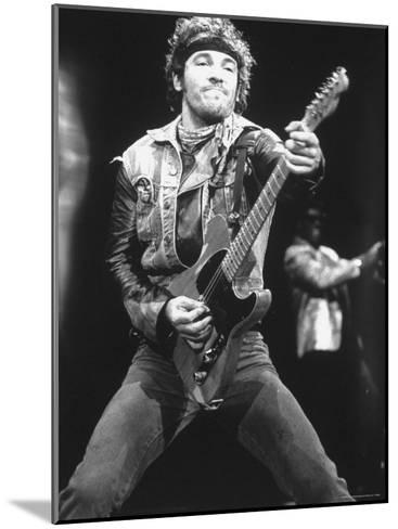 Rock Star Bruce Springsteen Playing Guitar in Concert-Kevin Winter-Mounted Premium Photographic Print
