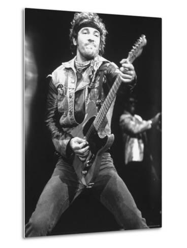 Rock Star Bruce Springsteen Playing Guitar in Concert-Kevin Winter-Metal Print