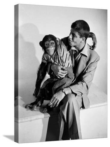 Entertainer Jerry Lewis with a Chimpanzee-Peter Stackpole-Stretched Canvas Print