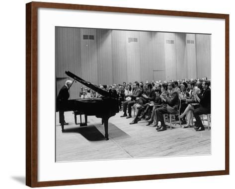 Pianist Artur Rubinstein Taking Bow Next to Grand Piano as Audience Enthusiastically Responds--Framed Art Print