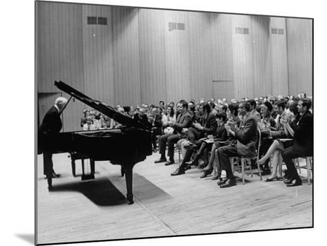 Pianist Artur Rubinstein Taking Bow Next to Grand Piano as Audience Enthusiastically Responds--Mounted Premium Photographic Print