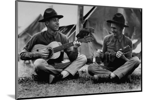 US Marine Sitting on Ground and Playing Guitar--Mounted Photographic Print