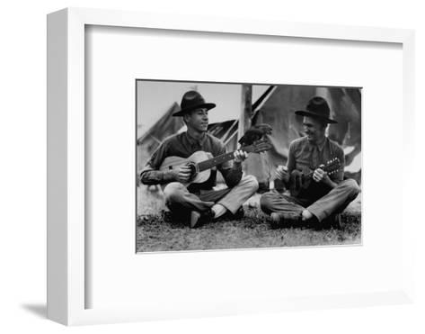 US Marine Sitting on Ground and Playing Guitar--Framed Art Print