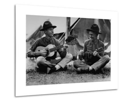 US Marine Sitting on Ground and Playing Guitar--Metal Print