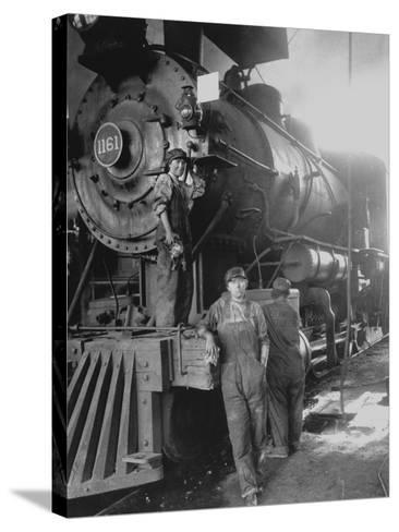 Women Rail Workers Standing at Work on Engine of Train, During WWI at Great Northern Railway--Stretched Canvas Print