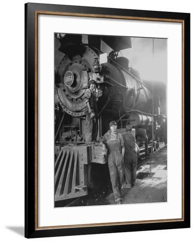 Women Rail Workers Standing at Work on Engine of Train, During WWI at Great Northern Railway--Framed Art Print