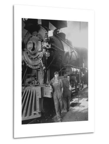 Women Rail Workers Standing at Work on Engine of Train, During WWI at Great Northern Railway--Metal Print