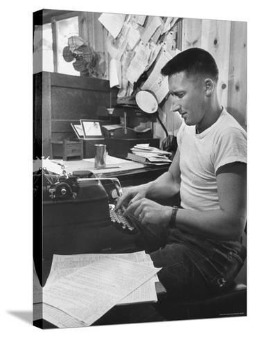 Mystery Writer Mickey Spillane Working at Typewriter at Desk Near Bulletin Board-Peter Stackpole-Stretched Canvas Print