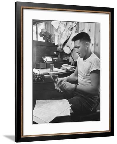 Mystery Writer Mickey Spillane Working at Typewriter at Desk Near Bulletin Board-Peter Stackpole-Framed Art Print