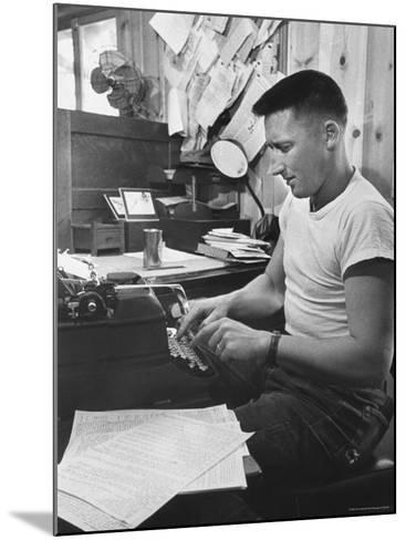 Mystery Writer Mickey Spillane Working at Typewriter at Desk Near Bulletin Board-Peter Stackpole-Mounted Premium Photographic Print