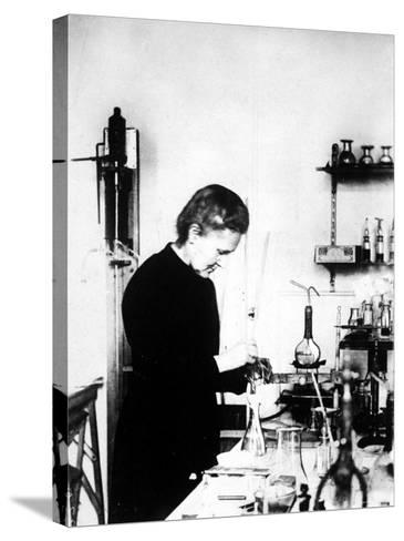 Chemist Marie Curie at Work in Her Laboratory--Stretched Canvas Print