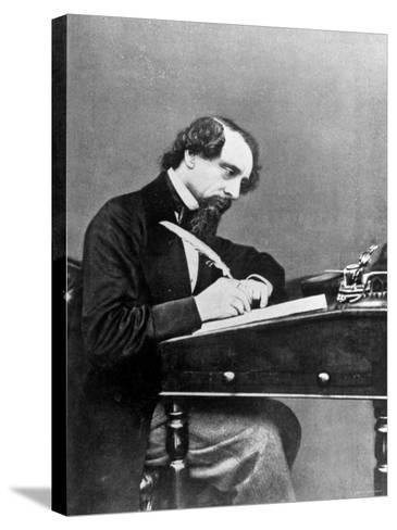 Prolific English Novelist Charles Dickens Seated Writing with a Quill Pen--Stretched Canvas Print