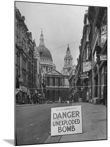 Danger Unexploded Bomb Sign at Cordoned Off Area in Front of St. Paul's Church-Hans Wild-Mounted Photographic Print