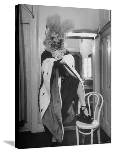 Soprano Patrice Munsel Costumed as Notary for Cosi Fan Tutte, Pulling onGloves in Dressing Room-Peter Stackpole-Stretched Canvas Print