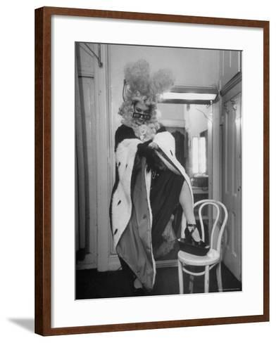 Soprano Patrice Munsel Costumed as Notary for Cosi Fan Tutte, Pulling onGloves in Dressing Room-Peter Stackpole-Framed Art Print