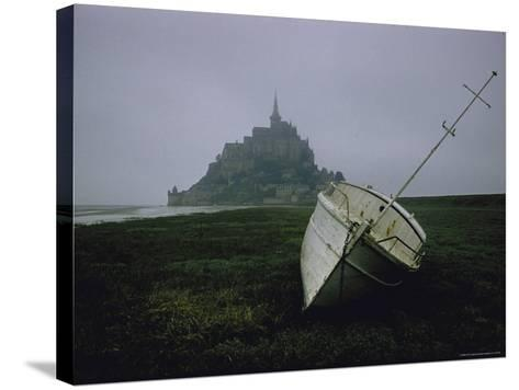 Boat and Mont St. Michel, Islet in Northwestern France, in the Gulf of Saint Malo-Walter Sanders-Stretched Canvas Print