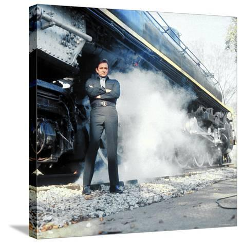 Country Music Star Johnny Cash Wearing Black Clothing and Standing in Front of a Locomotive-Michael Rougier-Stretched Canvas Print
