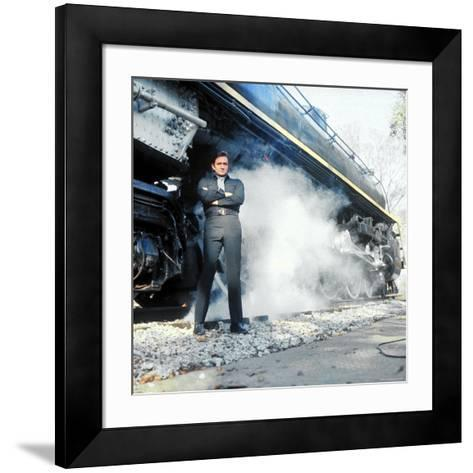 Country Music Star Johnny Cash Wearing Black Clothing and Standing in Front of a Locomotive-Michael Rougier-Framed Art Print
