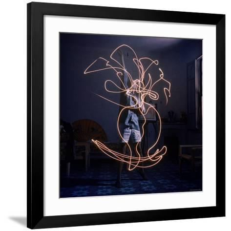 Pablo Picasso Drawing an Image Using a Light Pen-Gjon Mili-Framed Art Print