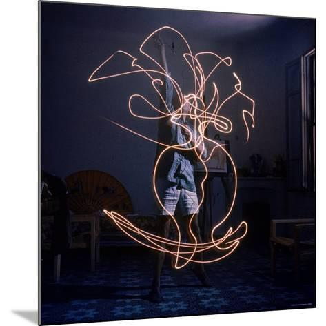 Pablo Picasso Drawing an Image Using a Light Pen-Gjon Mili-Mounted Premium Photographic Print