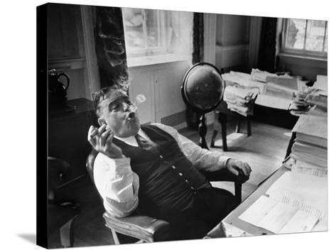 Mayor Fiorello LaGuardia Blowing Smoke Rings Sitting at Desk in His Office-William C^ Shrout-Stretched Canvas Print