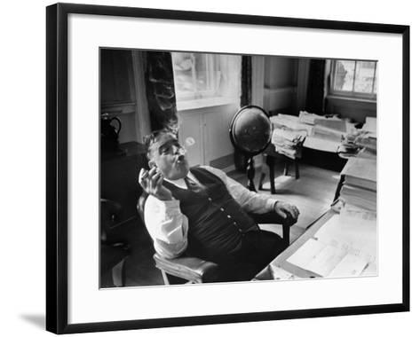 Mayor Fiorello LaGuardia Blowing Smoke Rings Sitting at Desk in His Office-William C^ Shrout-Framed Art Print
