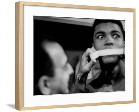 Heavyweight Contender Cassius Clay, Getting His Mouth Taped by Trainer Angelo Dundee-George Silk-Framed Art Print