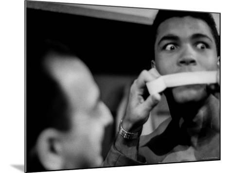 Heavyweight Contender Cassius Clay, Getting His Mouth Taped by Trainer Angelo Dundee-George Silk-Mounted Premium Photographic Print