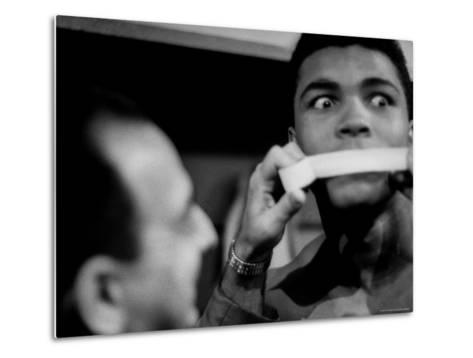 Heavyweight Contender Cassius Clay, Getting His Mouth Taped by Trainer Angelo Dundee-George Silk-Metal Print