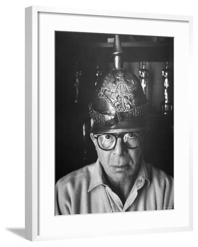 Director Billy Wilder in His Hollywood Office Wearing German Helmet-Gjon Mili-Framed Art Print