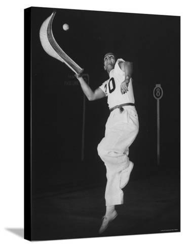 Mexican Jai Alai Player Segundo Jumping to Reach Pelota in Game at Hippodrome-Gjon Mili-Stretched Canvas Print