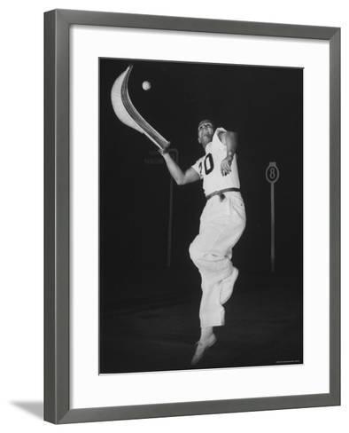 Mexican Jai Alai Player Segundo Jumping to Reach Pelota in Game at Hippodrome-Gjon Mili-Framed Art Print